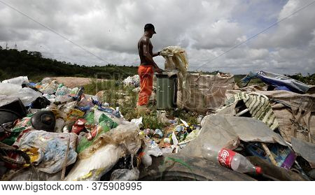 Catu, Bahia / Brazil - May 2, 2019: Person Is Seen Collecting Material For Recycling At The Landfill