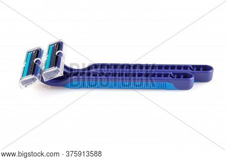 Two Blue Plastic Razors And A Shaving Blade Isolated On A White Background. New Disposable Razor Bla