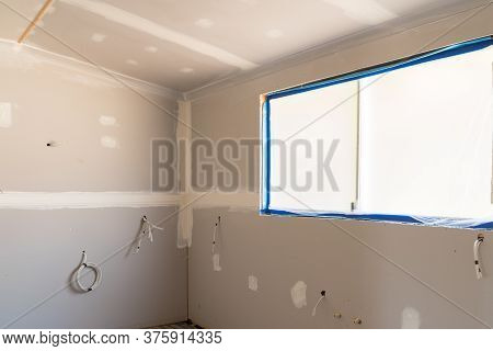 Renovating Old House With New Plasterboard In Kitchen Area With Wiring For Appliances