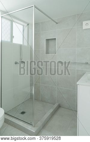 Small Ensuite Bathroom With Show Recess And Tiled Walls