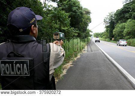Itabuna, Bahia / Brazil - February 28, 2012: Federal Highway Police Officer - Prf - Is Seen Using A