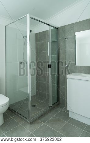 New Gray And White Bathroom With Tiled Walls And Floor