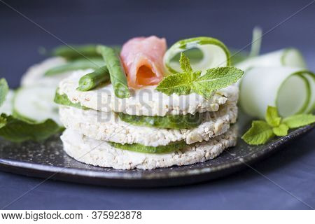 Healthy Food. Three Rice Cookies Sandwich With Red Fish. Rice Cakes With Cream Cheese And Red Fish.