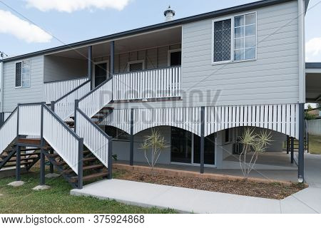 Old Queenslander Style Home After Renovation And Repaint, New Double Stairs