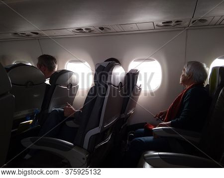 Russia, Novosibirsk 05.10.2019 Passengers In Seats In The Plane Aviation Flight Of Tourists On A Jou