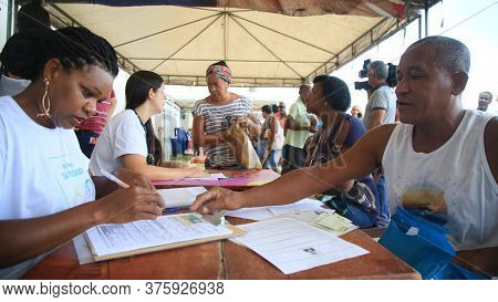Salvador, Bahia / Brazil - Nov. 6, 2019: Agents From Bahia Pesca, Register Fishermen And Shellfish F
