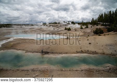 Steaming Geysers And Hot Spring Geothermal Features Of Norris Geyser Basin In Yellowstone National P