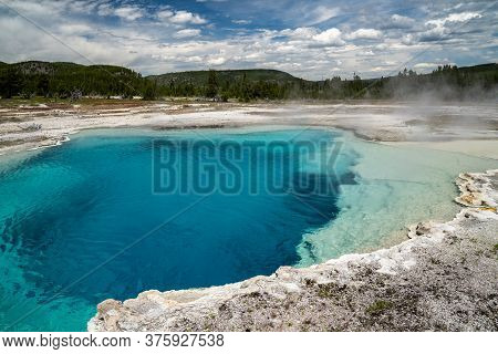 Sapphire Pool, Located In Biscuit Basin, In Yellowstone National Park Is A Geothermal Hot Spring Fea
