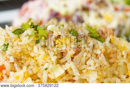 Thai Sour Pork Fried Rice And Salad In Dish With Natural Light In Close Up View
