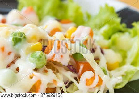 Vegan Salad Or Vegetarian Salad On Left Frame Include Carrot And Peas And Corn And Lettuce And Cabba