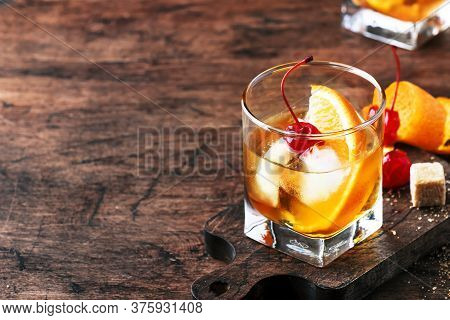 Old Fashioned - Classic Alcoholic Cocktail With Bourbon Whiskey, Bitter, Cane Sugar And Ice In Retro