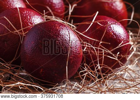 Sicilian Red Oranges In The Dried Straw On The Old Wooden Background, Selective Focus