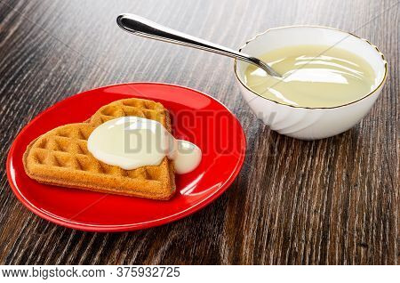 Heart Shaped Cookies Poured Condensed Milk In Red Glass Saucer, Teaspoon In Bowl With Condensed Milk