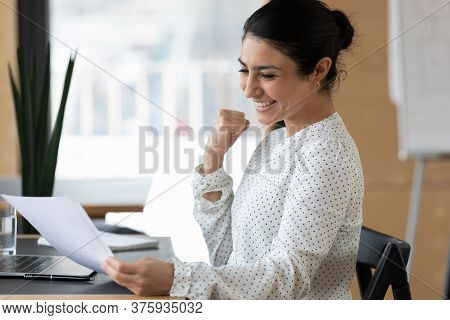 Happy Indian Female Employee Triumph Reading Good News In Letter