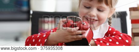 Little Cute Girl Looks At Alarm Clock And Laughs. Cute Games For Girls To Show Imagination. Developm