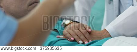 Hands Nurse Doing Heart Massage To Man In Clinic. Diagnosis And Treatment Cardiovascular Diseases. V