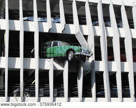Bordeaux , Aquitaine / France - 10 02 2019 : Jaguar Automobile Vintage Crosses The Wall Of The Car P