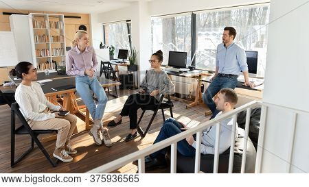 Multiracial Colleagues Engaged In Teambuilding Activity In Office
