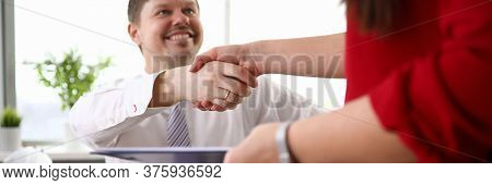 Close-up View Of Co-workers Shaking Hands And Smiling To Each Other. Man In Disabled Carriage. Worki