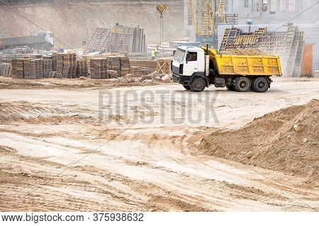 Multi-ton Heavy Mining Dump Truck Loaded During Removal Of Construction Soil From Construction Site.