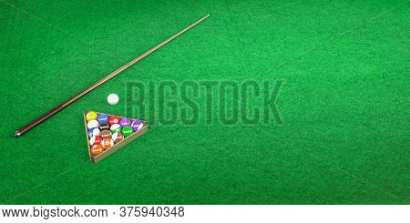 Billiard Cue And Pool Balls Lie On A Green Felt Background With Space For Text - Banner - 3d Render
