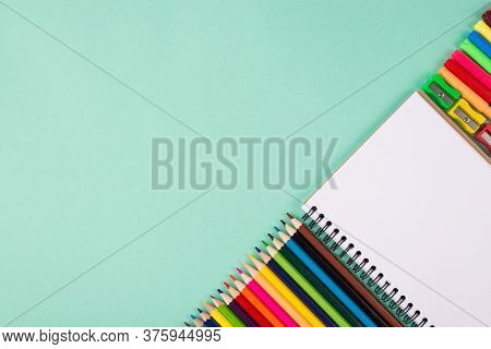 Back To School Concept. Top Above Overhead View Photo Of Colorful School Stationery Isolated On Turq