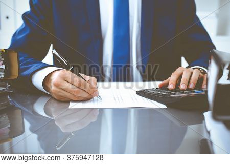 Bookkeeper Or Financial Inspector Hands Making Report, Calculating Or Checking Balance. Internal Rev