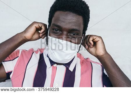 Young African Man Wearing Face Mask Portrait - Afro American Boy Using Protective Facemask For Preve