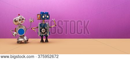 Two Robots Are Looking Away From Themselves. Creative Mechanical Toys, Steampunk Style. Copy Space F