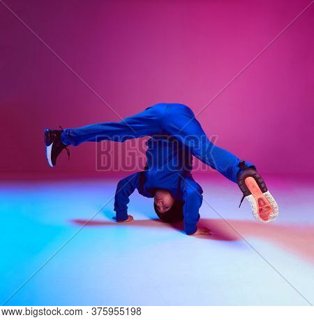 Boy Child Breakdancer Stands On Head Dancing Hip Hop In Neon Light. Dance School Poster. Battle Comp