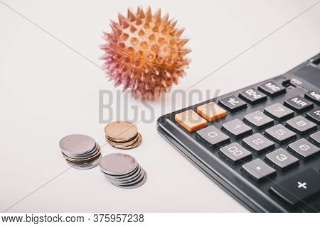 Coronavirus Or Covid-19 Ncov On The Economy. Coins, Calculator On The Desk. Medicine And Money Conce