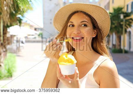 Close Up Of Tourist Girl Visiting Sirmione Town In Italy Holding Traditional Gelato Italian Ice Crea
