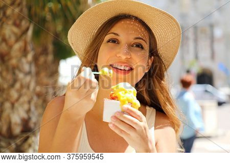 Close Up Of Tourist Girl Eating Gelato Traditional Italian Ice Cream In Sirmione Town, Italy. Young