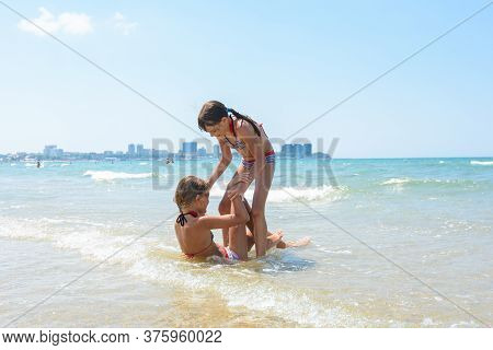 Two Girls Wallow Each Other In Shallow Sea