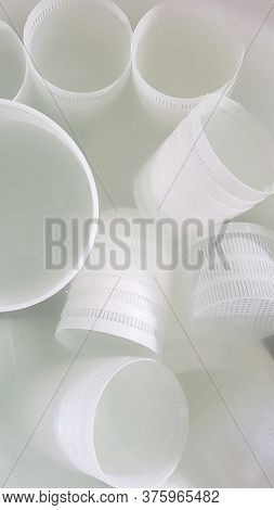 Plastic Forms For Ricotta Cheese Making In A Salt Water Bath Top View