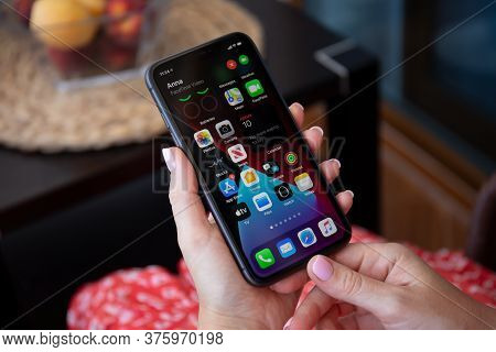 Alanya, Turkey - July 10, 2020: Woman Hand Holding Iphone 11 With Phone Call Widget On The Home Scre