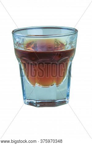 A Glass Of Brandy On A White Background Is Shot Very Close Up