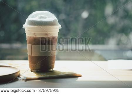 Iced Mocha Coffee On Wood Table In The Morning