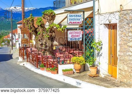 Meteora, Greece - April 27, 2015: Tables And Chairs At The Traditional Greek Tavern Surrounded With