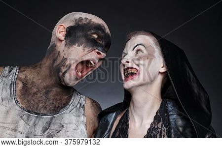 Photo Of Mad Screaming Man And Scary Woman With Blood Hands