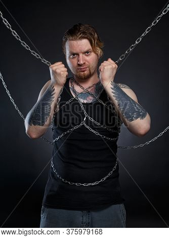 Photo Of A Brutal Man Bound In Chains