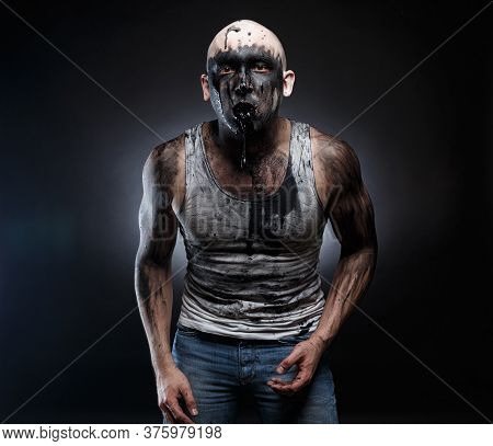Photo Of Bald Mad Man With Black Vomit In The Mouth