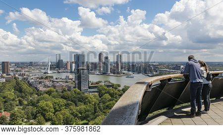 Rotterdam, The Netherlands, July 2020: Couple Looking Out Over The Skyline Of Rotterdam From Above,
