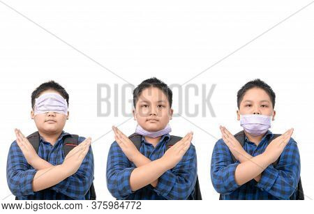 Wrong Way To Wear Surgical Mask, Schoolboy Wearing A Surgical Mask In The Wrong Way Isolated On Whit