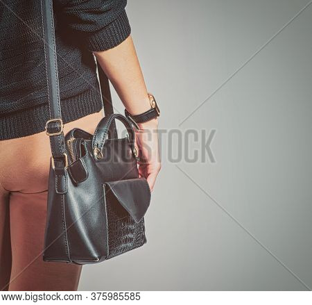 Handbag Is On The Shoulder On Fashionable Girl, Rear View