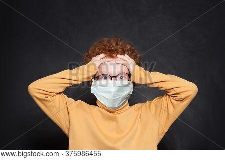 Shocked Child In Medical Protective Face Mask On Blackboard Background