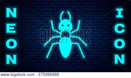 Glowing Neon Ant Icon Isolated On Brick Wall Background. Vector