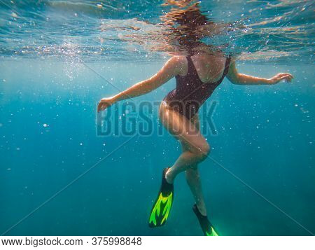 Woman In Flipper View Underwater Beach Vacation