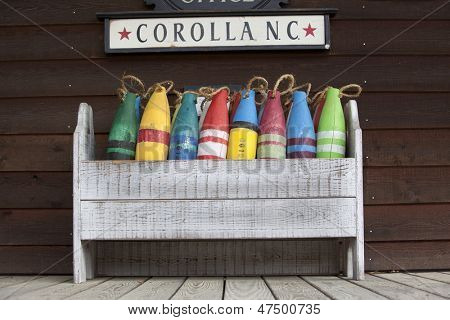 Buoy display in Corolla, North Carolina shows the rustic feel of the area.