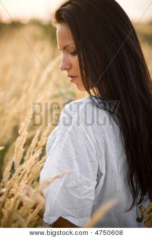 Beautiful Woman Outside In Field